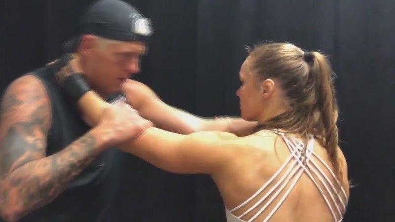 Ronda Rousey locking up with Wrestling legend Goldust backstage in Vienna LGv4