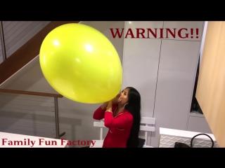 Family Fun Factory - Giant Yellow Balloon - Wonder Woman Blowing a Huge Balloon