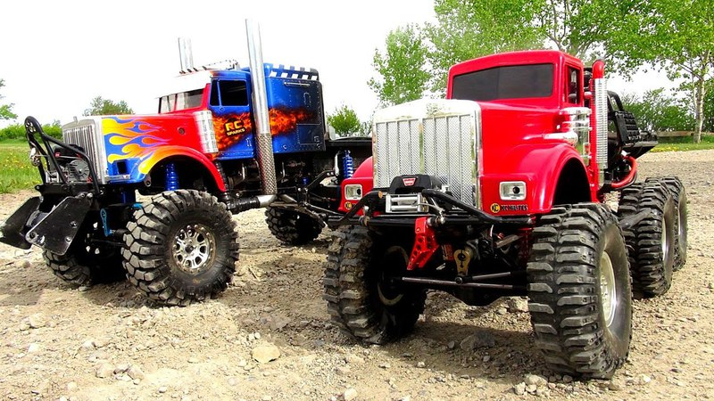 WHO CAN PULL MORE?! OPTiMUS vs BiG RED - iNSANE 6X6 RC TRUCKS Battle THE JUDGE | RC ADVENTURES