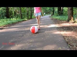 Pink platform sandals and beachball