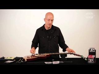 Как поменять струны на электрогитаре с фиксированным бриджем (перевод Global Sound)