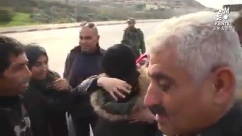 Scenes with rousing music of Palestinian young woman, Amal Qabaha, 17 upon her release from 1 1/12 yrs in Israeli prison