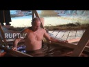 Russia Putin braves ice cold water for Epiphany dip