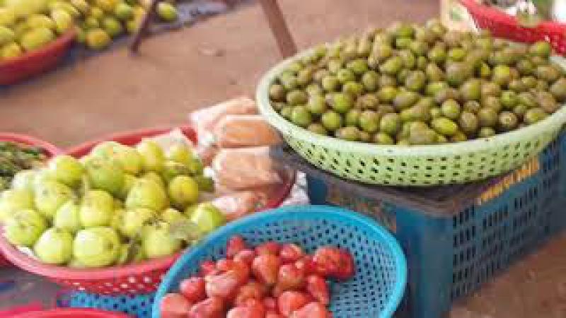 Around and in Pochentong market, Phnom Penh