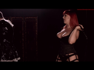 Mistress Amber Leigh smoking strong corks as she whips her slave