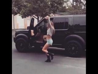Girl dancing near the car
