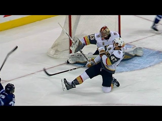 Lagace slides across to rob Laine's one timer with blocker save
