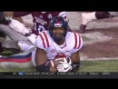 Ole Miss football player waves to the camera after fumble recovery
