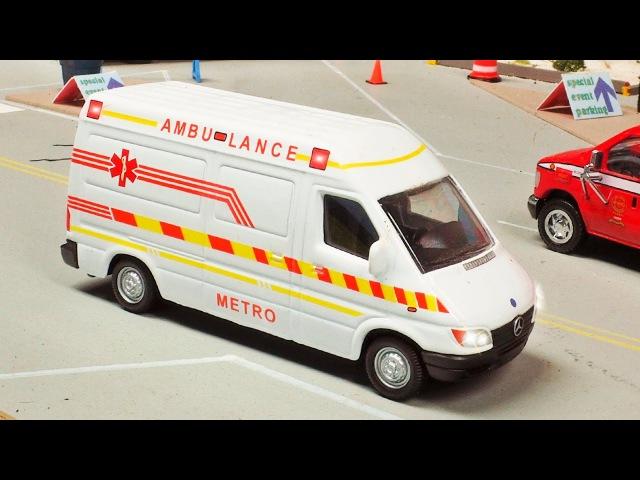 Krankenwagen, der Abschleppwagen und Feuerwehrauto, Herausforderung in Autostadt