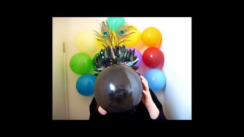 Masked girl blows to pop confetti balloon