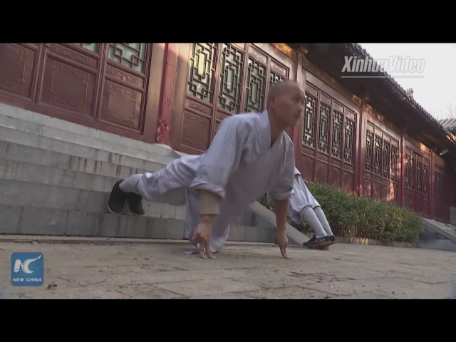 Shaolin monks perform fast, powerful kungfu