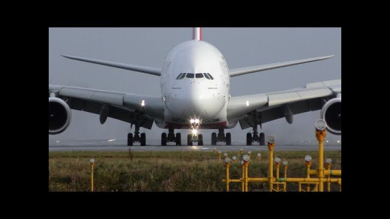 Impressive powerful reverse thrust Emirates Airbus A380 wet runway landing Manchester Airport