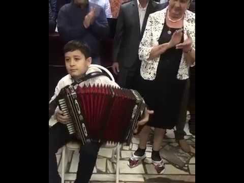 Сын Магамета Дзыбова (Рауль Дзыбов) играет на гармошке
