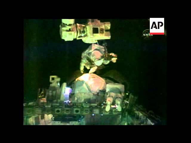 Watch as astronauts Rex Walheim and Stanley Love venture outside for the last spacewalk of the shutt