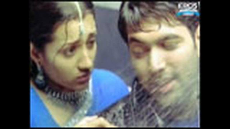 Jayam Ravi and Trisha under a shower - Something Something Unakkum Enakkum
