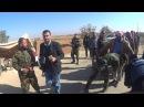 Под охраной русских «Тигров» Сотни боевиков сложили оружие