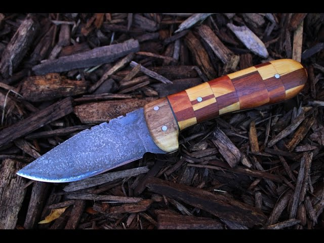 Making a drop point hunting knife from start to finish.