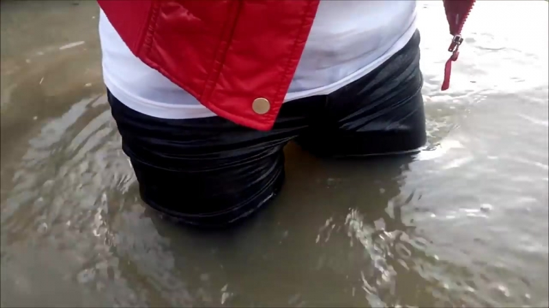 A girl in wet rubber boots and in wet jeans in deep water (2) MOV 0137 07112017
