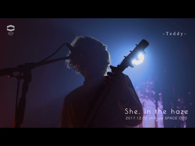 She, in the haze-