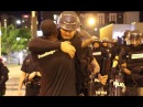 Man gives free hugs to riot police protesters in Charlotte RAW