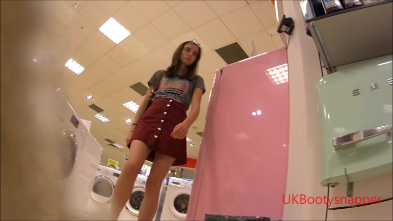 Brunette teen in red miniskirt and sexy white pants
