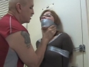 BoundHub Girl in glasses captured tape tied and tape gagged