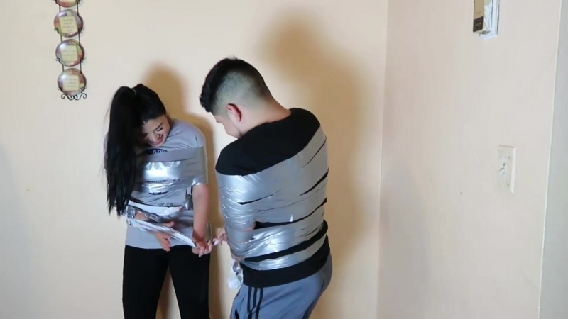 DUCK TAPE CHALLENGE! WITH MY SISTER