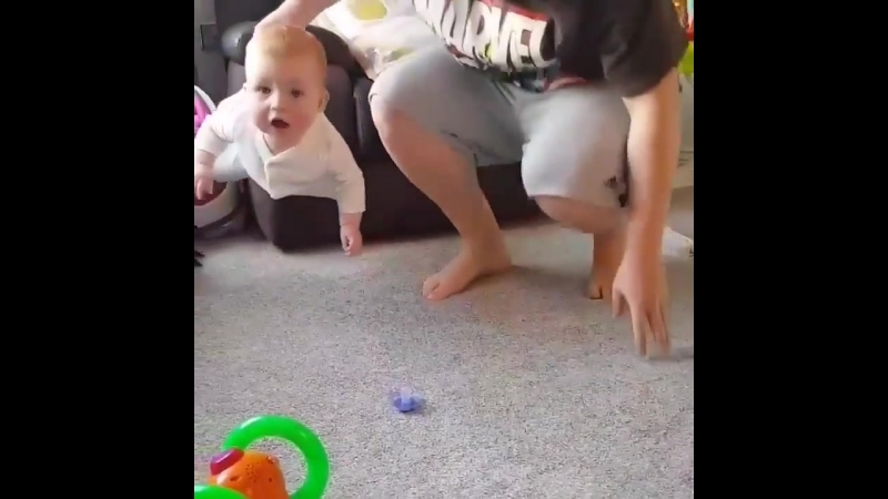 Lad holds daughter Mission Impossible style to pick up dummy