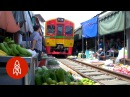 Watch a Train Run Through Thailand's Most Dangerous Market
