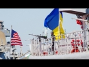 The Ukrainian Navy Hetman Sahaidachny frigate and the United States Navy missile destroyer Gravely are moored near one another.