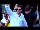 Chris Hemsworth waves the green flag in Indy 500