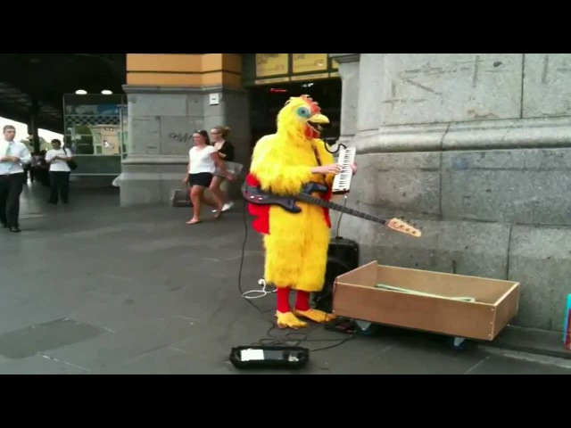 Man in a Chicken Suit plays