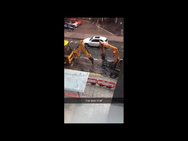 Two Diggers Playing Tic-Tac-Toe On The Pavement - When you're bored at work