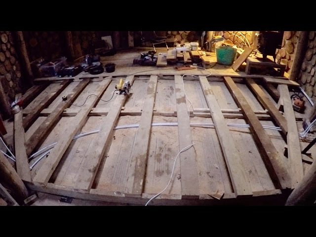 Off grid roundhouse build part 28 sealing the windows, finishing floor joists