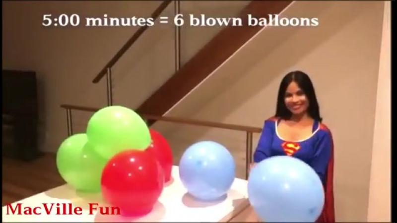 MacVille Adventures - Superman Logo Balloons - Supergirl Blowing Six Coloured Balloons