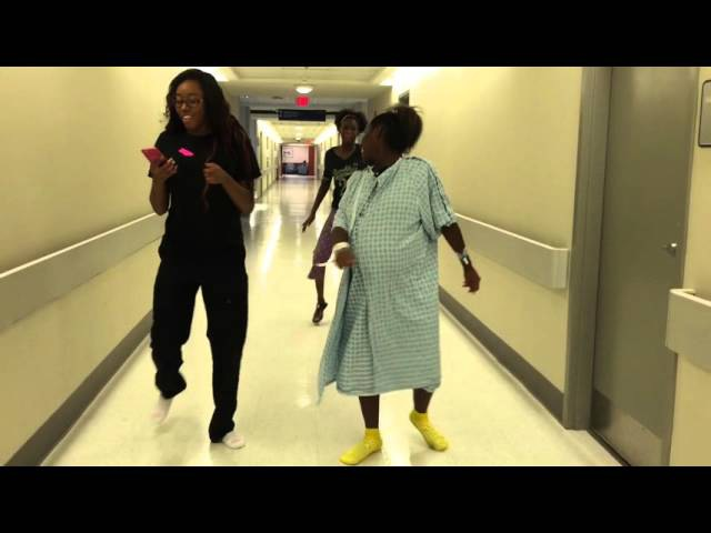 Mommy dancing baby down between contractions