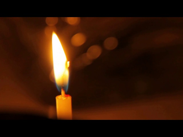 Candles and bokeh, spiritual background. Free stock footage