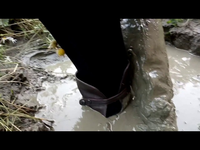 Girl in a black dress and high boots in deep mud VID 20170726 213034