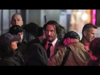 Keanu Reeves films intense action scene in the rain for