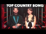 Darren Criss and Alison Brie presenting the award for Best Country Song on the BBMAs