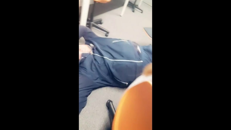 Lad falls off of computer chair
