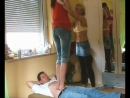 Young, tall beautiful girl tramples a guy with the help of her Mother.