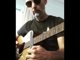 playing slide guitar with a kitchen knife.