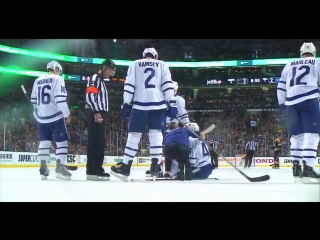Rielly takes all of a chara slap shot to face