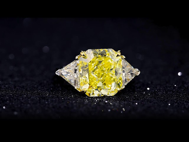7.65 Carat Fancy Vivid Yellow Diamond Ring with a GIA Report