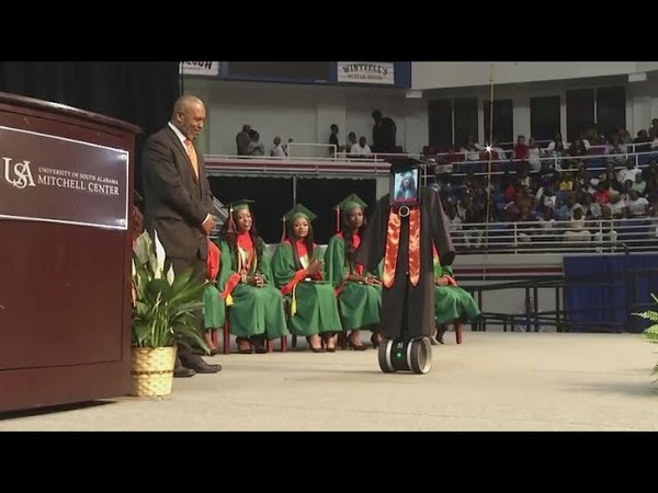 IPad dressed in cap and gown stands in for girl at graduation