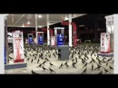 Huge flock of Grackles land at fuel station after midnight Dazzle Dallas Sky