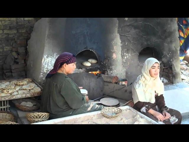 Making Arabic (Pita) Bread near the Giza Plateau Cairo, Egyp