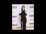 Mila Kunis wows in black dress for A Bad Moms Christmas