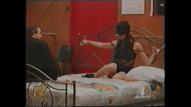 Natalia Estrada - Briefly tickled while handcuffed to a bed during a prank of the Italian tv show Scherzi a Parte